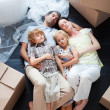 Beautiful family sleeping on the floor — Stock Photo