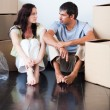 Stock Photo: Couple talking about thir new house