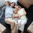 Famiy lying on floor after buying house — Stock Photo #10312269