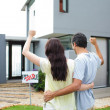 Happy couple after buying house — Stock Photo