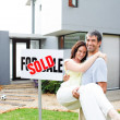 Couple celebrating their new house — Stock Photo