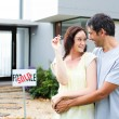 Stock Photo: Couple celebrating their new house