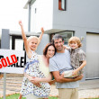 Family buying a house - Stock Photo