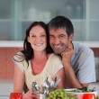 Stock Photo: Lovers eating fruit in the kitchen