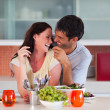 Royalty-Free Stock Photo: Lovers eating in the kitchen