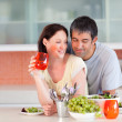 Royalty-Free Stock Photo: Couple eating and drinking in the kitchen