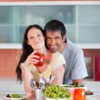 Stock Photo: Lovers eating in the kitchen
