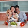 Royalty-Free Stock Photo: Smiling family eating in a kitchen