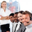 Business team in a call center with a bright female leader — Stock Photo