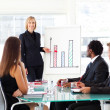 Businesswoman giving a presentation — Stock Photo