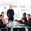 Stock Photo: Business applauding in presentation