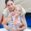 Stock Photo: Mother and daughter having fun outdoors