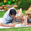Stock Photo: Father painting with his children