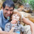 Portrait of a father and son blowing bubbles — Stock Photo