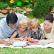 Happy family painting in a park - Stockfoto