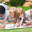 Stock Photo: Happy family writing in a park