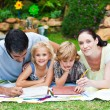 Happy family painting in a garden - Stockfoto
