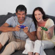 Smiling couple playing video games — Stock Photo #10312583
