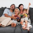 Cheerful family playing video games at home — Stock Photo #10312586