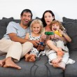 Cheerful family playing video games at home — Stock Photo #10312591