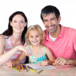 Parents and daughter drawing — Stock Photo
