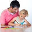 Dad and daughter doing homework together — Stock Photo