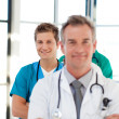 Stock Photo: Junior doctor in focus in line