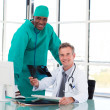 Royalty-Free Stock Photo: Professional doctors smiling at the camera