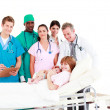Doctors with a mother and her newborn baby — Stock Photo #10312929