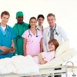 Stock Photo: Doctors attending to patient