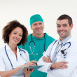 Stock Photo: Team of doctors looking at camera