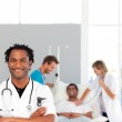 African doctor with his colleagues in the background with copy-s — Stock Photo #10313232