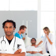 Serious doctor looking at the camera with copy-space — Stock Photo #10313236