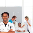 Doctor with folded arms looking at the camera with copy-space — Stock Photo #10313240