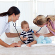 Baby with pediatrician and nurse — Stock Photo