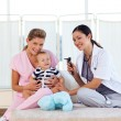 Baby with pediatrician and nurse with copy-space — Stock Photo
