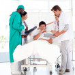 Doctors speaking to a patient — Stock Photo #10313403