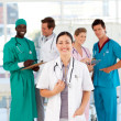 Doctor with colleagues in the background — Stock Photo