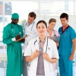 Female doctor with her team in the background — Stock Photo