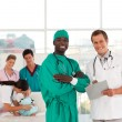 Portrait of a doctor with his team in the background — Stock Photo #10313482