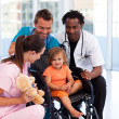 Little patient with medical team — Stock Photo