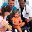 Portrait of a little patient with medical team — Stock Photo