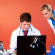 Young doctors working with a laptop in office — Stock Photo