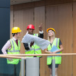 Diverses architects studying a building — Stock Photo