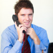 Stock Photo: Handsome businessperson talking on phone