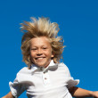 Stock Photo: Happy little boy having fun