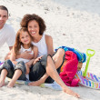Family playing sitting on a beach — Stock Photo #10313949