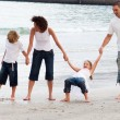 Royalty-Free Stock Photo: Family walking on a beach