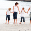 Family walking on a beach - Stock Photo