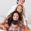 Joyful family having fun together on the bed — Stock Photo #10313996